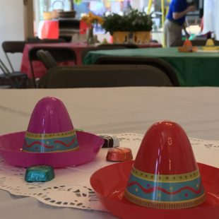 small toy sombreros on a table