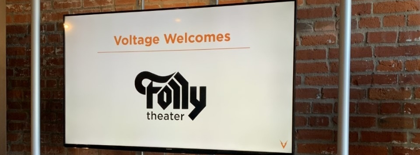 """sign with """"Voltage Welcomes Folly Theater"""""""