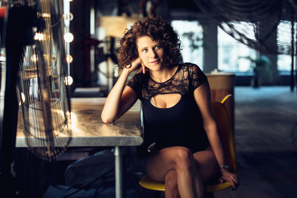 Cyrille Aimée sitting at a table