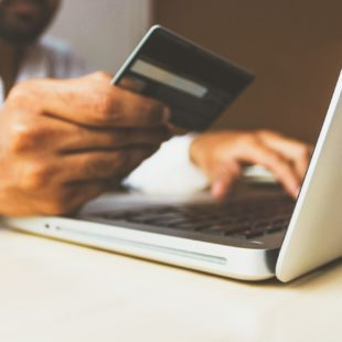 credit card being used on laptop